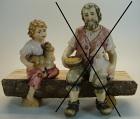 4336 Hei - Hirtenjunge sitzend mit Kitz